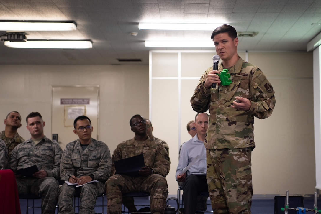 U.S. Air Force Staff Sgt. Dylan King, 18th Aeromedical Evacuation Squadron technician explains the potential innovation to 18th AES mission planning May. 10, 2019, at Kadena Air Base, Japan.
