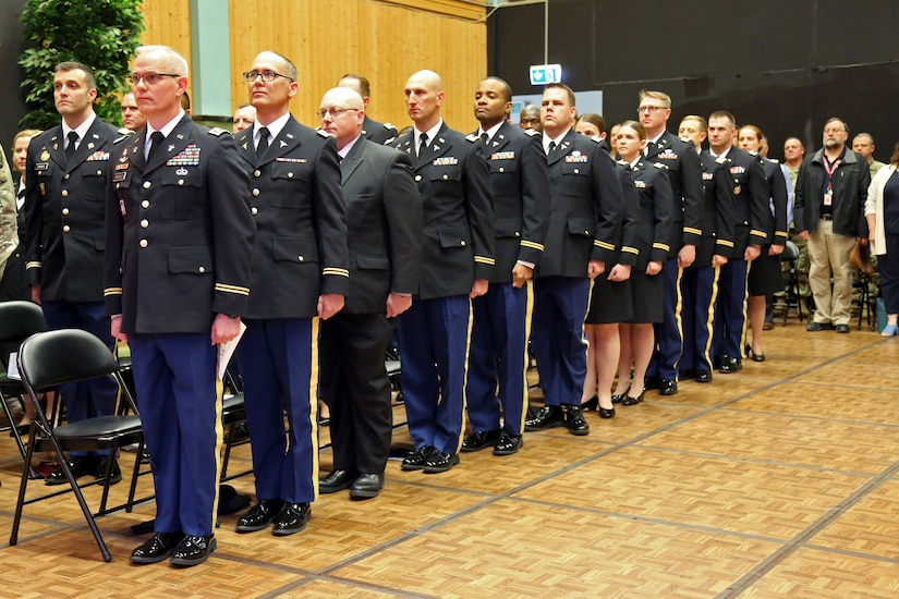 Intermediate Level Education (ILE) common core students stand at the start of a U.S. Army Command and General Staff Officers Course Common Core graduation ceremony hosted by the 7th ILE Detachment, 7th Mission Support Command, in Grafenwoehr, Germany, May 17, 2019. The 7th ILE DET offers a unique year-long ILE common core curriculum designed for multi-component officers deployed or stationed overseas.