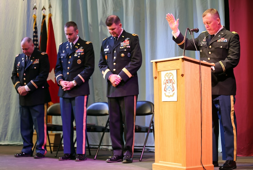 Chaplain (Maj.) Kevin Hovan, a common core graduate and chaplain with USAG Bavaria, leads the benediction during a U.S. Army Command and General Staff Officers Course Common Core graduation ceremony hosted by the 7th Intermediate Level Education Detachment, 7th Mission Support Command, in Grafenwoehr, Germany, May 17, 2019. The 7th ILE DET offers a unique year-long ILE common core curriculum designed for multi-component officers deployed or stationed overseas.