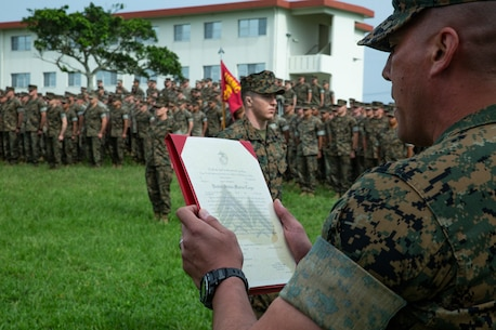 Sgt. Maj. Al Torres, the sergeant major of Battalion Landing Team, 1st Battalion, 4th Marines, reads a promotion warrant during a visit from Lt. Gen. Joseph L. Osterman, the commanding general of I Marine Expeditionary Force, Camp Hansen, Okinawa, Japan, May 2, 2019. Lt. Gen. Osterman visited the Marines of BLT 1/4 before they depart Okinawa to conclude their deployment with the 31st Marine Expeditionary Unit. The 31st Marine Expeditionary Unit, the Marine Corps' only continuously forward-deployed MEU, provides a flexible and lethal force ready to perform a wide range of military operations as the premier crisis response force in the Indo-Pacific region. (U.S. Marine Corps photo by Lance Cpl. Tanner D. Lambert/Released)