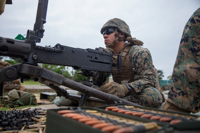 Pfc. Yaxel Santiagorodriguez, a landing support specialist with Combat Logistics Battalion 31, prepares to fire an M2 .50-caliber machine gun during machine gun training at Camp Hansen, Okinawa, Japan, May 3, 2019. During the training, Marines with CLB-31 fired several thousand rounds to increase and maintain proficiency with medium and heavy machine guns. Santiagorodriguez, a native of Haines City, Florida, graduated from Haines City High School in June 2018 before enlisting in June of the same year. The 31st MEU, the Marine Corps' only continuously forward-deployed MEU, provides a flexible and lethal force ready to perform a wide range of military operations as the premier crisis response force in the Indo-Pacific region. (Official U.S Marine Corps photo by Lance Cpl. Kevan Dunlop/Released)