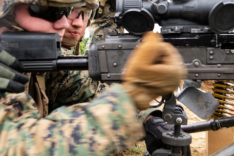 Lance Cpl. Michael Barclay, a landing support specialist with Combat Logistics Battalion 31, pulls the charging handle of an M240B medium machine gun during training at Camp Hansen, Okinawa, Japan, May 3, 2019. Barclay, a 20 year old native of Newport News, Virginia, graduated from Woodside High School in June 2017 before enlisting in August 2018. During the training, Marines with CLB-31 fired several thousand rounds to refine their abilities with medium and heavy machine guns. CLB-31 is the Logistics Combat Element for the 31st Marine Expeditionary Unit. The 31st MEU, the Marine Corps' only continuously forward-deployed MEU partnering with the U.S. Navy's Amphibious Squadron 11, provides a flexible and lethal force ready to perform a wide range of military operations as the premier crisis response force in the Indo-Pacific region. (U.S. Marine Corps photo by Gunnery Sgt. T. T. Parish/Released)
