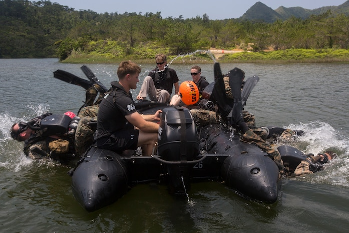 Reconnaissance Marines with the 31st Marine Expeditionary Unit's Force Reconnaissance Platoon roll backward into the water during training at Camp Hansen, Okinawa, Japan, May 13, 2019. The FRP Marines train regularly for quick, tactical raids of targets both on land and sea to fulfill the specialized raid missions the 31st MEU is capable of conducting during deployments. The 31st MEU, the Marine Corps' only continuously forward-deployed MEU, provides a flexible and lethal force ready to perform a wide range of military operations as the premier crisis response force in the Indo-Pacific region. (Official U.S Marine Corps photo by Lance Cpl. Cameron E. Parks /Released)