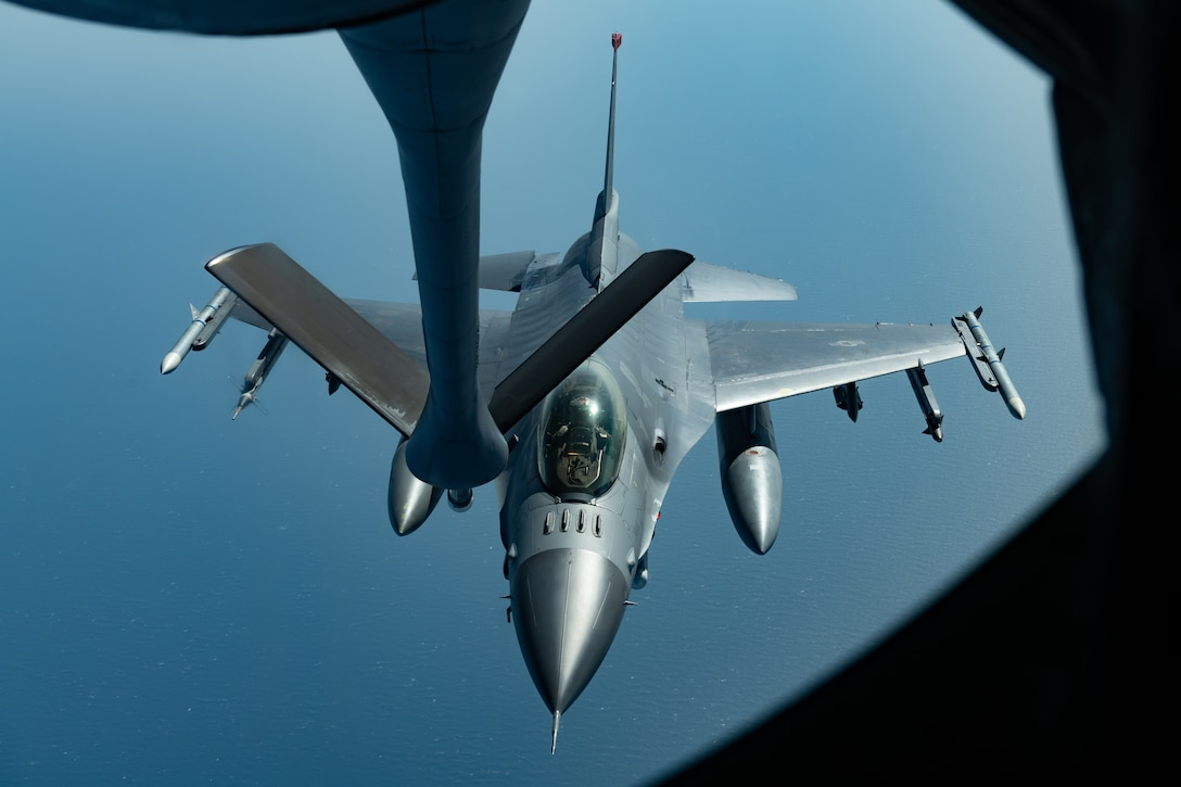 An F-16CM Fighting Falcon from the 35th Fighter Wing, Misawa Air Base, prepares to refuel with a KC-135 Stratotanker from the 909th Air Refueling Squadron, Kadena Air Base, during a routine training exercise off the coast of Japan, May 8, 2019. The 909th ARS helps ensure a free-and-open Indo-Pacific by providing air refueling to U.S., allies and partners within the area of responsibility. (U.S. Air Force photo by Airman 1st Class Matthew Seefeldt)