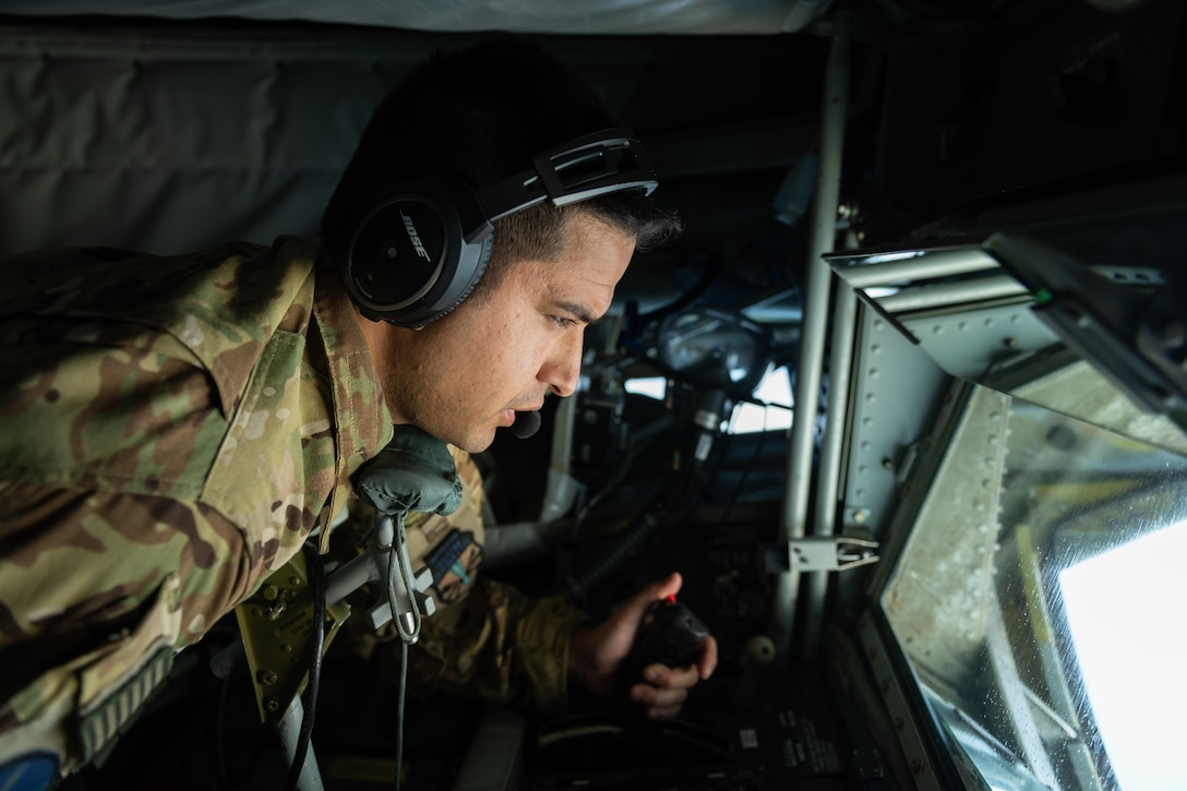 U.S. Air Force Technical Sergeant Chance Italiano, 18th Air Refueling Squadron boom operator, works the controls in his boom pod during a routine training exercise off the coast of Japan, May 8, 2019. The 909th ARS helps ensure a free-and-open Indo-Pacific by providing air refueling to U.S., allies and partners within the area of responsibility. (U.S. Air Force photo by Airman 1st Class Matthew Seefeldt)