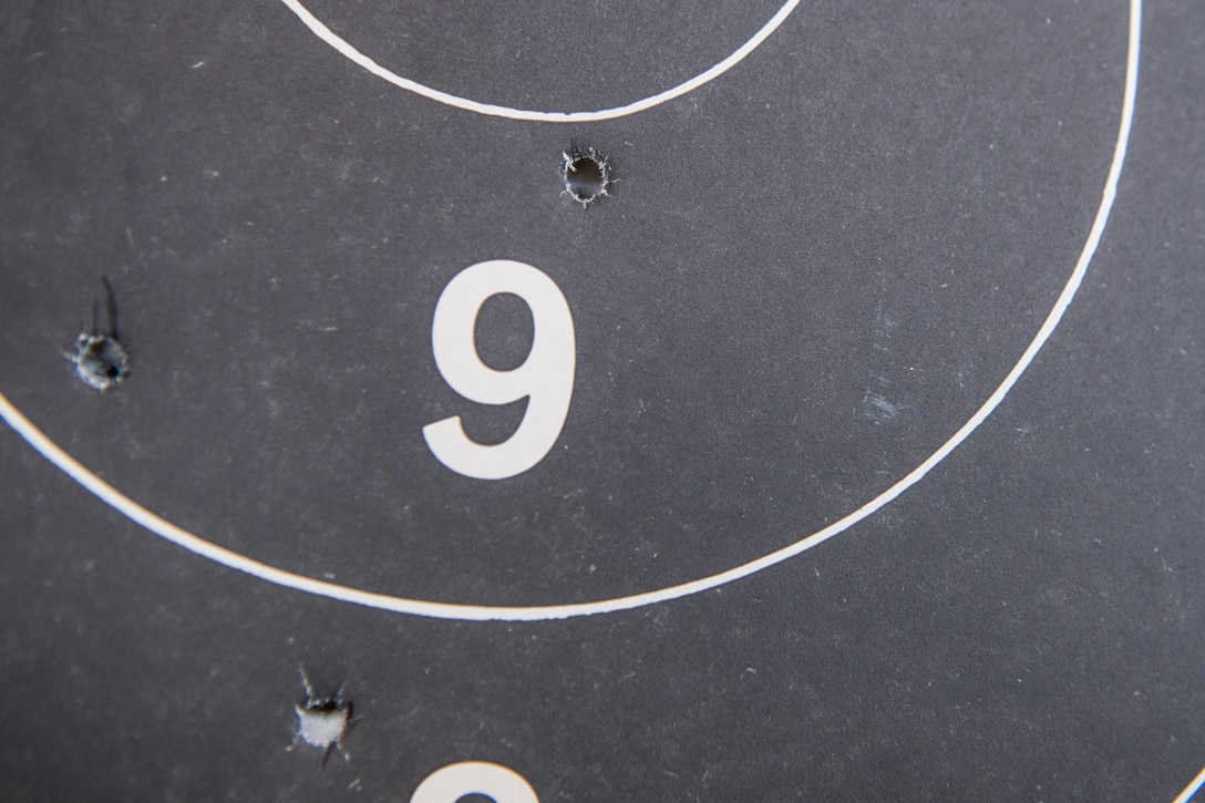 A target punctured with bullet waits to be tallied during a shooting competition on May 17, 2019, at Incirlik Air Base, Turkey. Competitors gained points based on how well they hit their targets, with the winner receiving a small prize at the end of the event. (U.S. Air Force photo by Senior Airman Joshua Magbanua)