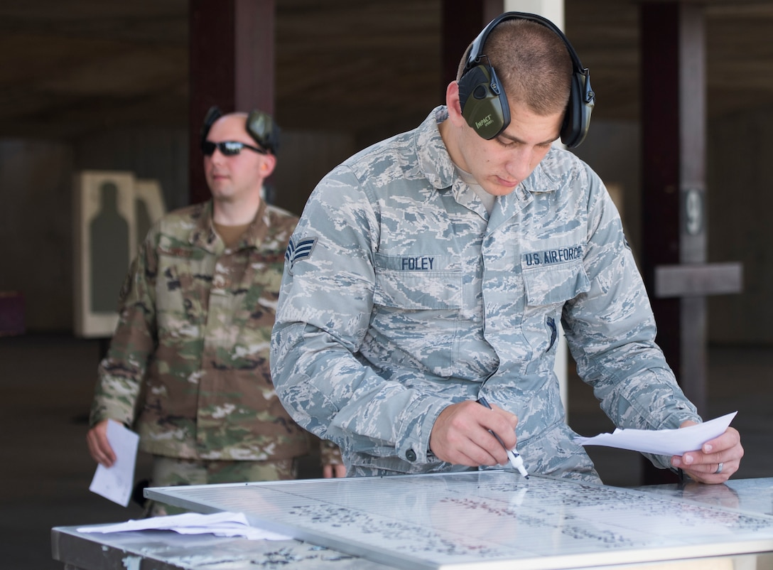 Senior Airman Cameron Foley, 39th Security Forces Squadron security response team member, checks contestants' scores during a shooting competition on May 17, 2019, at Incirlik Air Base, Turkey. The 39th SFS invited Airmen from across Incirlik to participate in the competition as part of the 39th Air Base Wing's Police Week observance. Police Week commemorates law enforcement officers who have fallen in the line of duty.(U.S. Air Force photo by Senior Airman Joshua Magbanua)