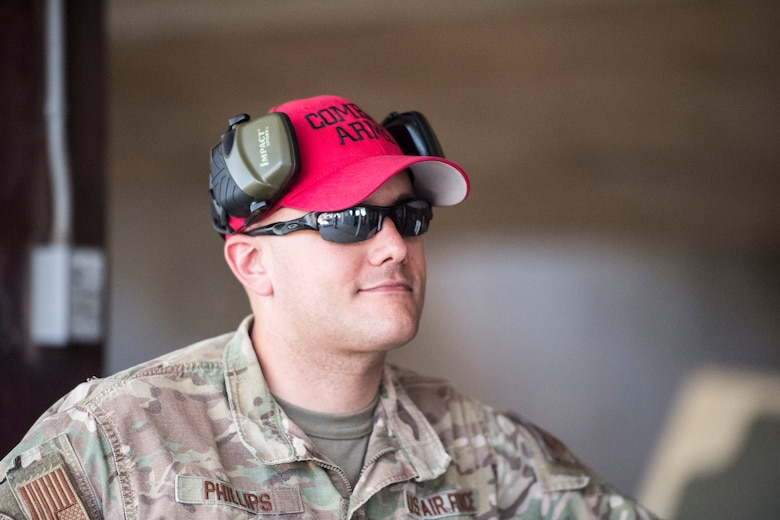 Staff Sgt. Kyle Philips, 39th Security Forces Squadron combat arms instructor, takes a break in between firing sessions during a shooting competition on May 17, 2019, at Incirlik Air Base, Turkey. More than 30 competitors attended the event, which was designed to commemorate Police Week and promote camaraderie among Incirlik Airmen. (U.S. Air Force photo by Senior Airman Joshua Magbanua)