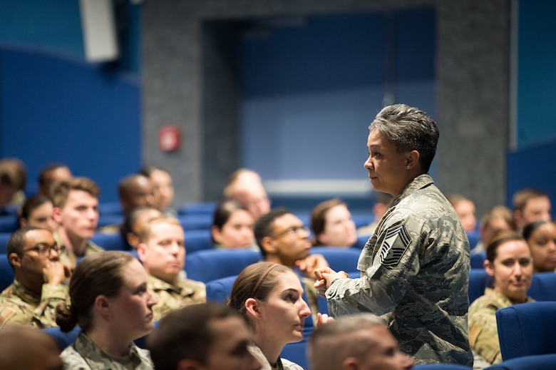 U.S. Air Force Chief Master Sgt. Rebecca Baxter, Air Force Personnel Center superintendent of personnel operations directorate, discusses enlisted personnel matters at the AFPC Roadshow Town Hall at the Hercules Theater, May 13, 2019 on Ramstein Air Base, Germany. During the town hall, AFPC briefers spoke to 86th Airlift Wing military and civilians on changes to processes and policies regarding personnel matters. (U.S. Air Force photo by Staff Sgt. Jimmie D. Pike)