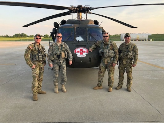 Staff Sgt. Jeremy Lowe, Chief Warrant Officer Cliff Flanagan, Capt. Jonathan Strayer, Staff Sgt. Shaun Morris, left to right, with Charlie Company, 2nd battalion, 238th Aviation, responded to a request for assistance from Wolfe County Emergency Management for a hoist rescue near Slade, Ky., May 18, 2019. The Guardsmen conducted a medical evacuation of a patient from a cliff in Natural Bridge State Park.