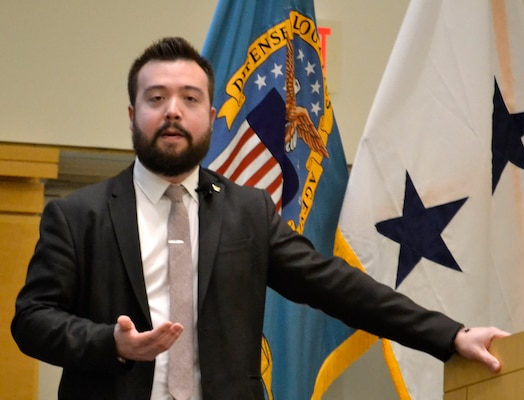 Rob Buscher, a member of the board of the Japanese American Citizens League Philadelphia Chapter and program director at Philadelphia's Fleischer Art Memorial, speaks about Japanese Americans in World War II at an event celebrating Asian American and Pacific Islander Heritage Month at DLA Troop Support May 16, 2019 in Philadelphia.
