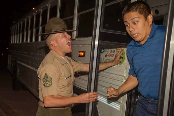 A drill instructor with Receiving Company, Support Battalion, welcomes a new recruit with India Company, 3rd Recruit Training Battalion, to recruit training during receiving at Marine Corps Recruit Depot San Diego, May 13.