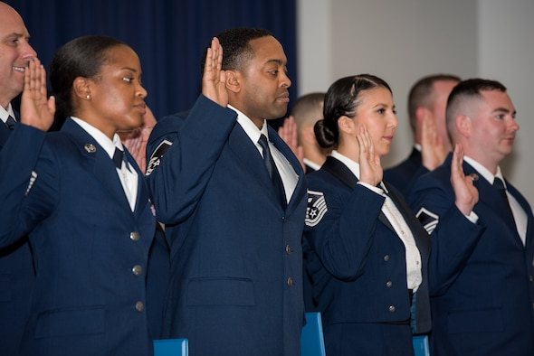 Airmen from the 512th Airlift Wing raise their right hands during a senior non-commissioned officer induction ceremony held at The Landings in Dover, Delaware, May 18, 2019. Thirty-two newly promoted master sergeants were charged with new responsibilities as they accepted the role within their new rank. (U.S. Air Force photo by Staff Sgt. Damien Taylor)