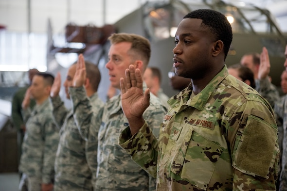 Airmen from the 512th Airlift Wing raise their right hands during a non-commissioned officer induction ceremony held at the Air Mobility Command Museum in Dover, Del., May 19, 2019. Seventy-seven newly promoted staff sergeants were charged with new responsibilities as they accepted the role within their new rank. (U.S. Air Force photo by Capt. Katie Spencer)