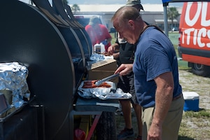 The 920th Rescue Wing held a biannual family day, at Patrick Air Force Base, Florida, Saturday, May 4, complete with food, games and live music. The local VFW outfit served up charcoal favorites during the festivities. (U.S. Air Force photo)