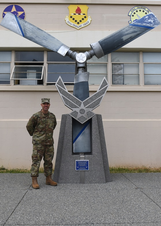 U.S. Air Force Chief Master Sgt. James Curtis, 311th Training Squadron first sergeant, stands with a heritage exhibit at Presidio of Monterey, Calif., May 6, 2019. Curtis has been the first sergeant for the 311th TRS for three years before being assigned to Nellis Air Force Base. (U.S. Air Force photo by Airman 1st Class Zachary Chapman/Released)