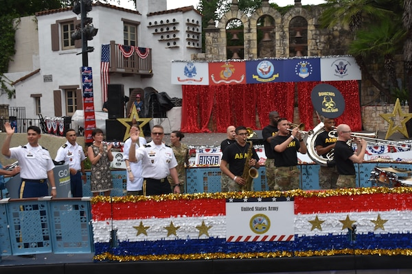 "Brig. Gen. Bill Boruff waves to the crowd as the Army float passes the Arneson River Theater during the annual Armed Forces River Parade May 18 in downtown San Antoniox. This year's theme was ""Salute Our Heroes."" The parade promotes awareness of the joint presence and ties to the military families and community. Representing the U.S. Army in this year's parade were Boruff, commanding general, Mission and Installation Contracting Command; MICC Command Sgt. Maj. Marcos Torres,  and Capt. Jim Jimenez, aide de camp for the MICC commanding general."