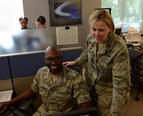U.S. Air Force Maj. Melissa Danley, commander of the 118th Force Support Squadron, Tennessee Air National Guard, examines the work of Airman 1st Class Willie Williams, a personnelist with the 118th FSS, May 14, 2019 at Berry Field Air National Guard Base, Nashville, Tennessee.