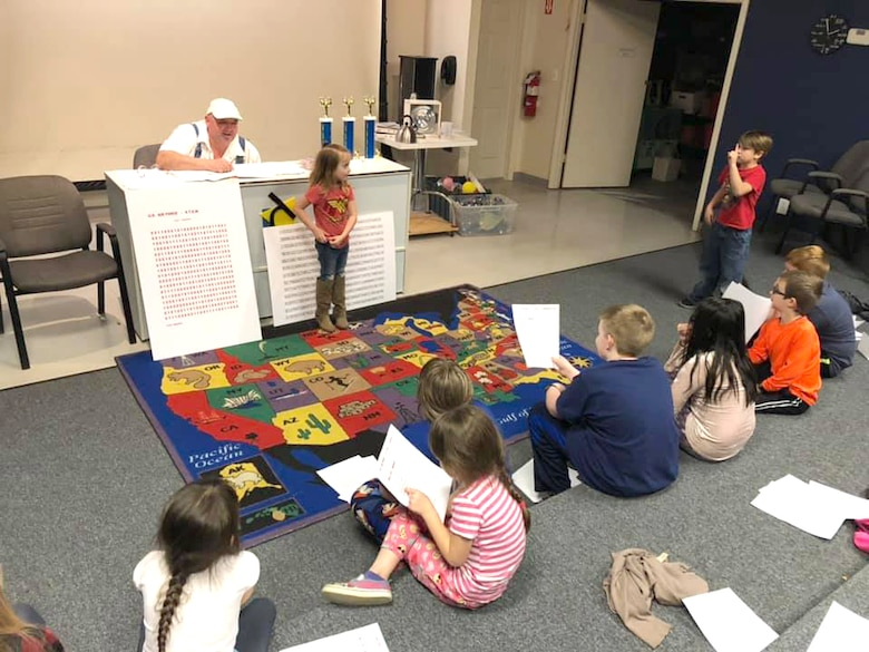 Chuck Mangino, left, one of the special guests during the Spring Camp at the Hands-On Science Center, teaches the campers the significance of Pi and gives them some tips on how to work on their memorization skills. (Courtesy photo)