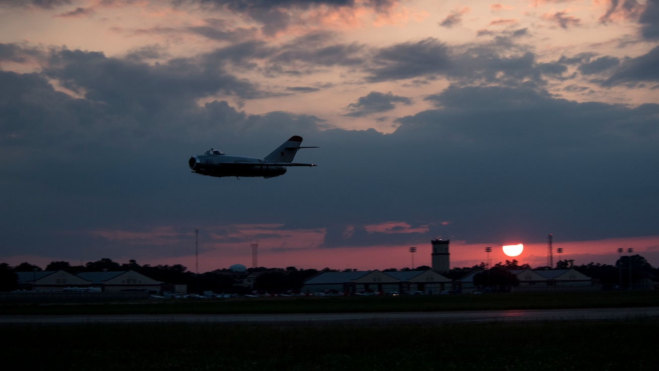 A MiG-17F performs a flyover during the Twilight Show at Barksdale Air Force Base, La., May 17, 2019. The Twilight Show allowed air and ground crews to practice processes and procedures a day before the Defenders of Liberty Air & Space Show. (U.S. Air Force photo by Staff Sgt. Damon Kasberg)
