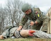 Polish Soldier applies tourniquet