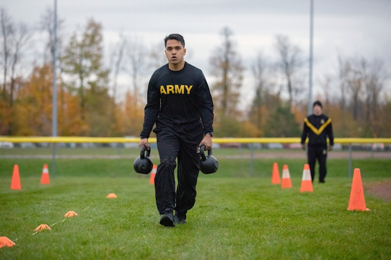 A Soldier assigned to Fort Drum, N.Y. carries two 40 pound kettle bells during a field test for the new Army Combat Fitness Test, Nov. 1, 2018. (U.S. Army photo by Staff Sgt. James Avery)