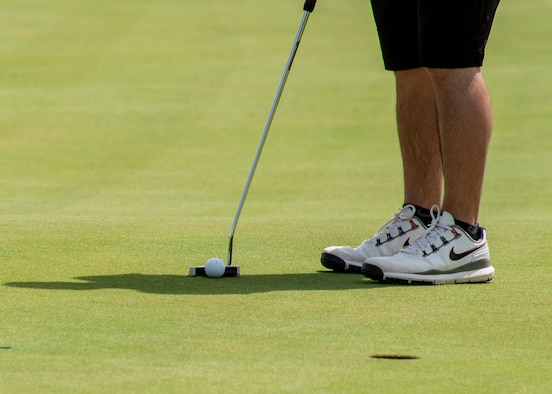 An Armed Forces Golf Championship participant prepares to putt, May 16, 2019, at Falcon Dunes Golf Course near Luke Air Force Base, Ariz.