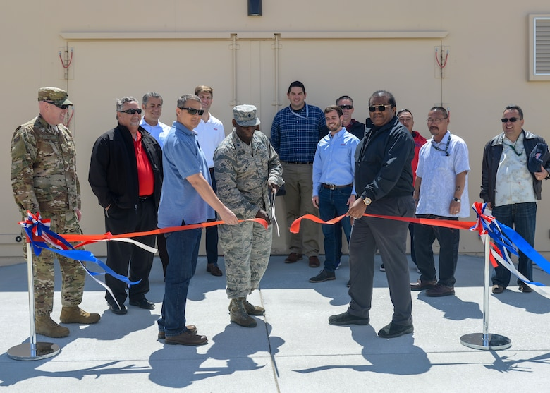 Lt. Col. Arnold Bowen, 412th Maintenance Group Deputy Commander, cuts the ribbon to officially open a new munitions bunker during a ceremony at Edwards Air Force Base, Calif. May 16. (U.S. Air Force photo by Giancarlo Casem)