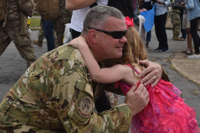 U.S. Air Force Reserve Lt. Col. Chris Dickens, 327th Airlift Squadron chief pilot, hugs his daughter after returning from deployment at Little Rock Air Force Base, Arkansas, May 19, 2019.