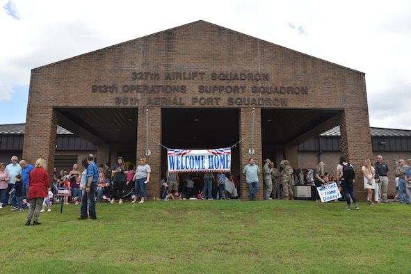 Family members of Team Little Rock gather at the 327th Airlift Squadron to greet returning Reserve Citizen Airmen at Little Rock Air Force Base, Arkansas, May 19, 2019
