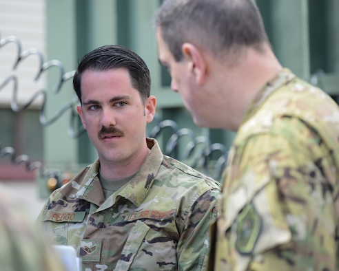 U.S. Air Force Senior Airman Josh Pedigo, 86th Vehicle Readiness Squadron vehicle operator, speaks with Brig. Gen. Mark R. August, 86th Airlift Wing commander on Ramstein Air Base, Germany, May 17, 2019.