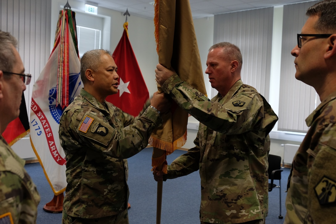 Col. Alexis M. Wells (left) outgoing commander of the 510th Regional Support Group, 7th Mission Support Command hands over the unit´s guidon to Brig. Gen. Fred R. Maiocco, commander of the 7th MSC during a change of command ceremony held at U.S. Army Garrison Rheinland-Pfalz, Sembach May 19, 2019. (US Army photo by Sgt. Daniel J. Friedberg, 7th MSC Public Affairs Office).