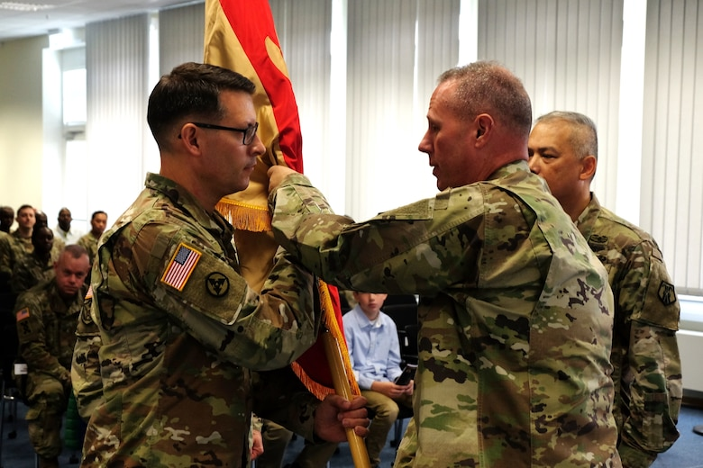 Col. Aaron J. Justice (left) commander of the 510th Regional Support Group, 7th Mission Support Command accepts the unit´s guidon from Brig. Gen. Fred R. Maiocco, commander of the 7th MSC during a change of command ceremony held at United States Army Garrison Rheinland-Pfalz, Sembach May 19, 2019. (US Army photo by Sgt. Daniel J. Friedberg, 7th MSC Public Affairs Office).