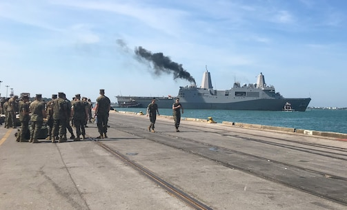 U.S. Marines and Sailors prepare to embark the San Antonio-class amphibious transport dock USS New York (LPD 21) before departing in Morehead City, N.C., May 18, 2019. Marines, Sailors and Coast Guardsmen will be in New York to interact with the public, demonstrate capabilities and teach the people of New York about America's sea services. (U.S. Marine Corps photo by Cpl. Jered T. Stone)
