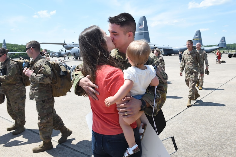 An Airman kisses his wife on the flight line