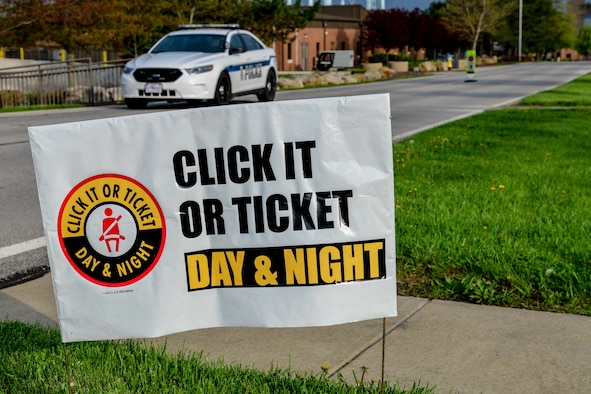 A sign portrays Youngstown Air Reserve Station's participation in the Click it or Ticket national seat belt campaign.