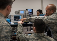 Airmen from the Precision Measurement Equipment Laboratory at Joint Base McGuire-Dix-Lakehurst, New Jersey, look over data readings April 10, 2019. Measuring over 18,000 items per year, PMEL plays a crucial part in keeping parts and instruments working effectively and efficiently. (U.S. Air Force photo by Senior Airman Jake Carter)