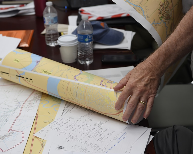An inspector working for the Naval Treaty Implementation Program uses a map to find potential areas to inspect during the International Chemical Weapons Convention exercise May 16, 2019, at Naval Weapons Station Charleston, Joint Base Charleston, S.C. The Naval Treaty Implementation Program provides comprehensive arms control treaty support to Navy and Marine Corps commanding officers, program managers, senior leadership and decision-makers. The purpose of the exercise is to test the response of base assistance teams should the U.S. receive an international challenge inspection under the Chemical Weapons Convention Treaty. The Chemical Weapons Convention aims to eliminate an entire category of weapons of mass destruction by prohibiting the development, production, acquisition, stockpiling, retention, transfer or use of chemical weapons by States Parties. Exercises like these support the Department of Defense's priority of reformation and full spectrum readiness in the face of new challenges. (U.S. Air Force photo by Senior Airman Cody R. Miller)