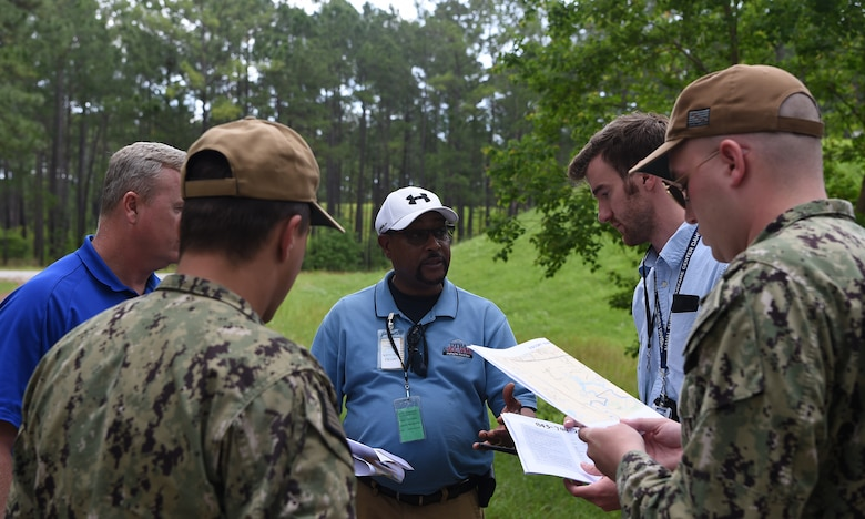 Inspectors and their military escorts working with the Defense Threat Reduction Agency and Naval Treaty Implementation Program prepare to inspect munitions bunkers during the International Chemical Weapons Convention exercise May 16, 2019, at Naval Weapons Station Charleston, Joint Base Charleston, S.C. The purpose of the exercise is to test the response of base assistance teams should the U.S. receive an international challenge inspection under the Chemical Weapons Convention Treaty. The Chemical Weapons Convention aims to eliminate an entire category of weapons of mass destruction by prohibiting the development, production, acquisition, stockpiling, retention, transfer or use of chemical weapons by State Parties. Exercises like these support the Department of Defense's priority of reformation and full spectrum readiness in the face of new challenges. (U.S. Air Force photo by Senior Airman Cody R. Miller)