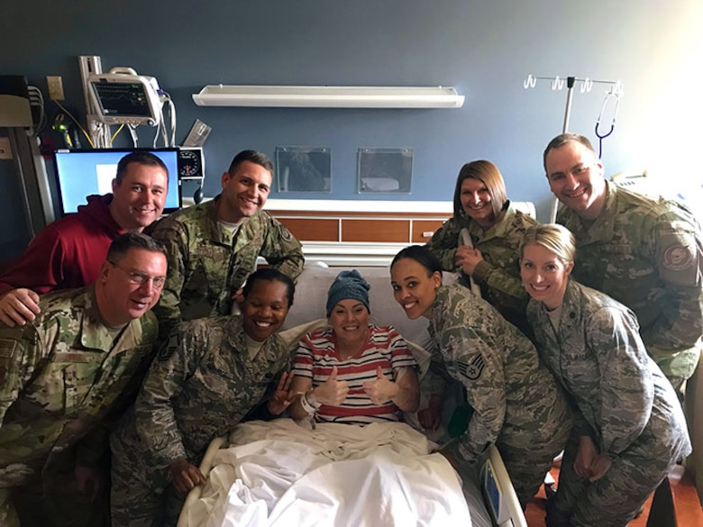 Master Sgt. Charlotte Ortiz, the assistant recruiting and retention superintendent for Headquarters, Ohio Air National Guard in Columbus, Ohio, exhibits her positive, joyful spirit during a visit with her co-workers, at Miami Valley Hospital in Dayton, Ohio. Ortiz is fighting a very rare type of cancer.