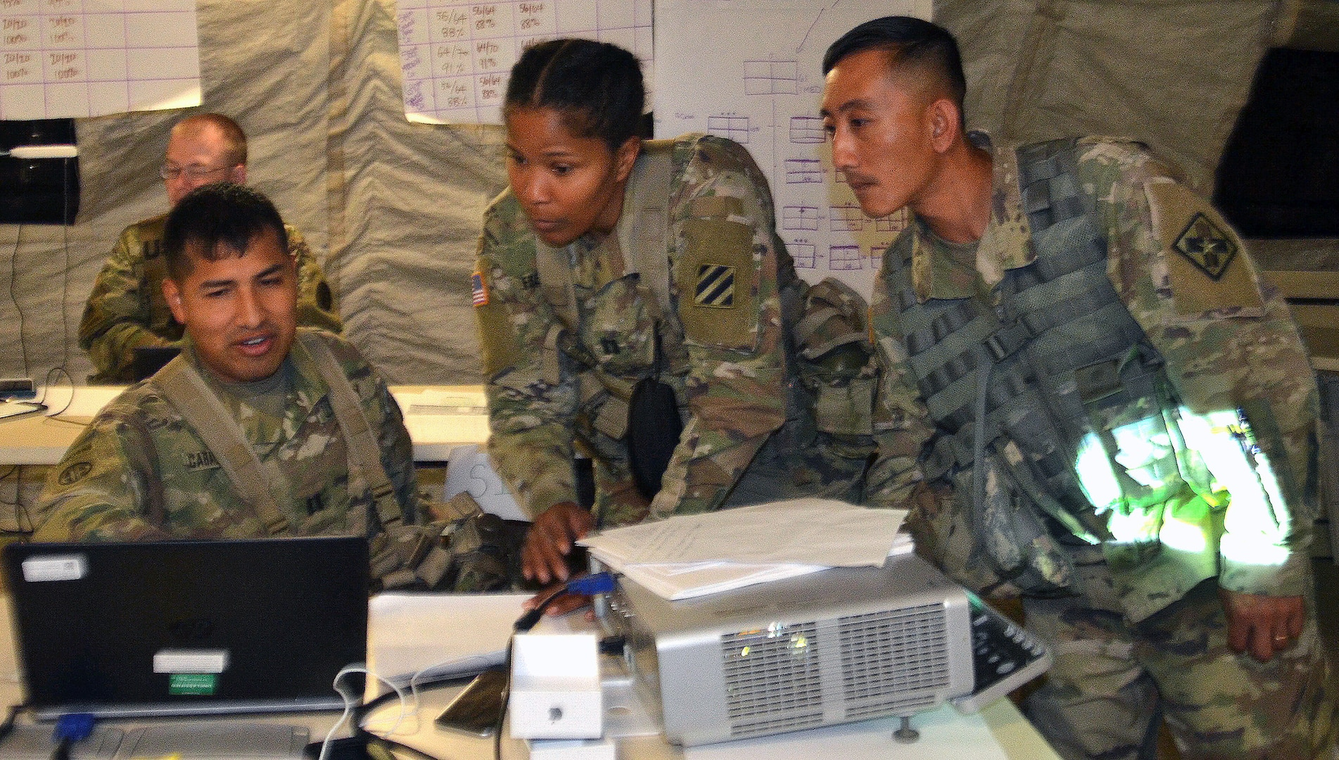 Army Medical Department Center & School, Health Readiness Center of Excellence students participate in a field training exercise for the Captains Career Course at Joint Base San Antonio-Camp Bullis May 7. From left to right are Capt. Jonatan Caballero, 3rd Cavalry Regiment medical support operations officer at Fort Hood, Texas; Capt. Romia Freeman, 3rd Combat Aviation Brigade behavioral health officer at Hunter Army Airfield, Ga.; and Chief Warrant Officer Phoutthasone Inthalangsy, Medical Education and Training Campus chief of curriculum support at Joint Base San Antonio-Fort Sam Houston. During the exercise, the students were part of a medical brigade putting together a disaster relief plan to support civil authorities responding to a hurricane that made landfall at Houston. Students in the Captains Career Course undergo nine weeks of training that includes classroom and hands-on training about the Military Decision Making Process, Army Health Systems Support and Force Health Protection doctrine, unit training management, leadership skills and staff officer functions.