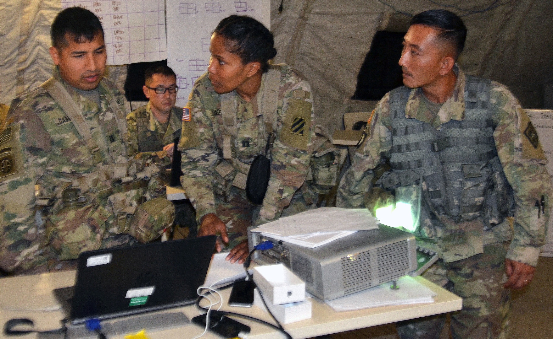 Army Medical Department Center & School, Health Readiness Center of Excellence students participate in a field training exercise for the Captains Career Course at Joint Base San Antonio-Camp Bullis May 7. From left to right are Capt. Jonatan Caballero, 3rd Cavalry Regiment medical support operations officer at Fort Hood, Texas; Capt. Romia Freeman, 3rd Combat Aviation Brigade behavioral health officer at Hunter Army Airfield, Ga.; and Chief Warrant Officer Phoutthasone Inthalangsy, Medical Education and Training Campus chief of curriculum support at Joint Base San Antonio-Fort Sam Houston. During the exercise, the students were part of a medical brigade putting together a disaster relief plan to support and help civil authorities responding to a hurricane that hit Houston. Students in the nine-week Captains Career Course learn about and undergo hands-on training on concepts, processes and skills to prepare them to lead medical units in support of ground combat operations and assisting civil authorities in emergency situations.