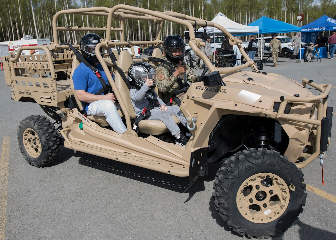 The 673d Security Forces Squadron personnel provide participants an opportunity to ride on a Utility Task Vehicle during a Police Week demonstration at Joint Base Elmendorf-Richardson, Alaska, May 14, 2019. In commemoration of Police Week, multiple demonstrations and activities were organized to highlight defender-style training and work conduct.