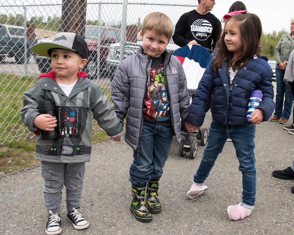 The 673d Security Forces Squadron family members visit various defender-guarded facilities at Joint Base Elmendorf-Richardson, Alaska, May 16, 2019. In commemoration of Police Week, multiple demonstrations and activities were organized to highlight defender-style training and work conduct which included a defender family day tour.