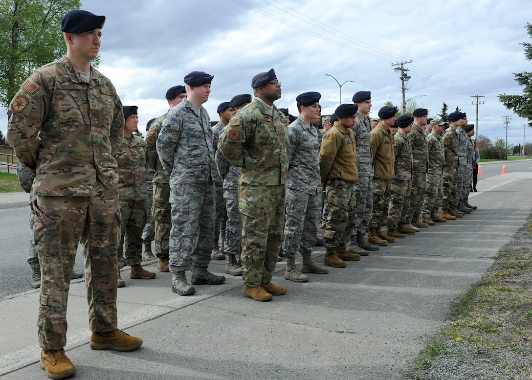 A group of 673d Security Forces Squadron personnel stand in formation during a Final Guard Mount Memorial Service at Joint Base Elmendorf-Richardson, Alaska, May 17, 2019. The memorial service was dedicated to the defenders who have paid the ultimate sacrifice while in combat.
