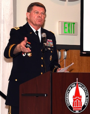 """Retired Army Lt. Gen. Guy Swan III, former commanding general of U.S. Army North, speaks to future service members, their families, educators, business leaders, and the military during """"A Night in Your Honor"""" hosted by Our Community Salutes-San Antonio held in the Rosenberg Sky Room at the University of the Incarnate Word May 15."""