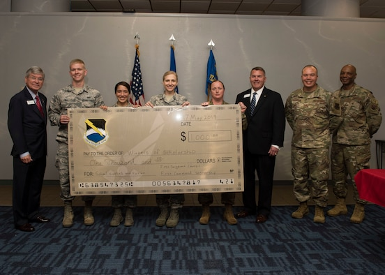 Four U.S. Air Force Airmen from Tyndall Air Force Base, Florida, are awarded $1,000 scholarships, May 17, 2019 at Tyndall AFB.