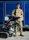 U.S. Army Sgt. Nicholas Thongdara poses for a photo with equipment utilized by the 35th Civil Support Team (Weapons of Mass Destruction). Thongdara is a chemical specialist with the 35th CST and is a descendent of Laos. (U.S. Air National Guard photo by Maj. Holli Nelson)