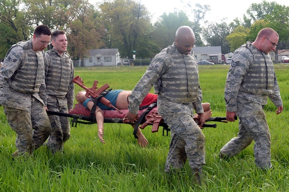 Participants of the Raider Challenge perform a casualty evacuation carrying 50 pounds of sandbags through an obstacle course May 15, 2019, at Offutt Air Force Base, Nebraska. In 1962, President John F. Kennedy signed a proclamation which designated May 15 as Peace Officers Memorial Day and the concurrent week as Police Week. (U.S. Air Force photo by Kendra Williams)