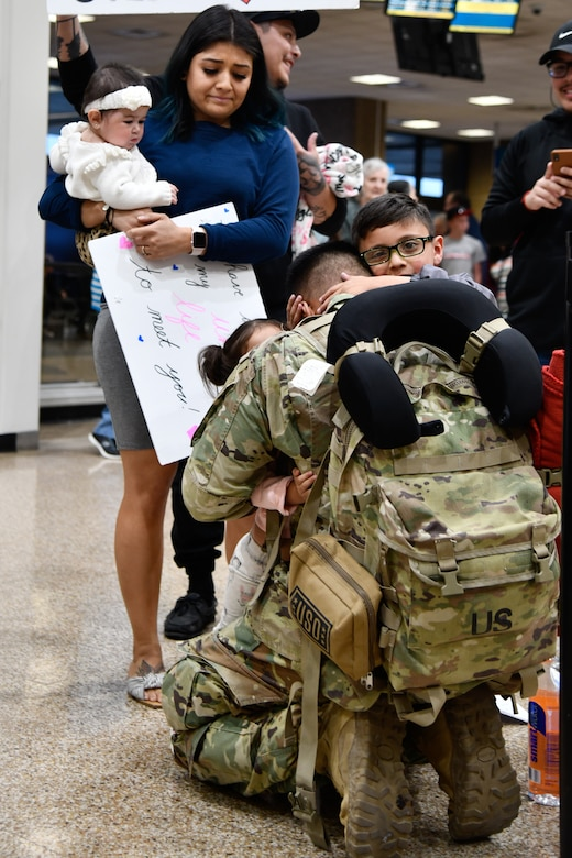 Soldier assigned to 2-211th Aviation Regiment reunites with his family after 11 months